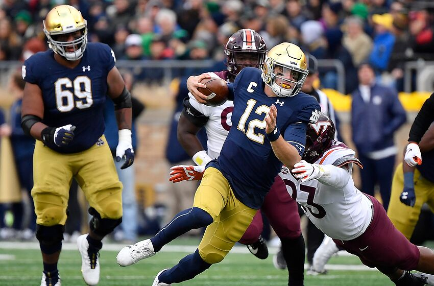 SOUTH BEND, INDIANA - NOVEMBER 02: Ian Book #12 of the Notre Dame Fighting Irish runs with the football in the first half against the Virginia Tech Hokies at Notre Dame Stadium on November 02, 2019 in South Bend, Indiana. (Photo by Quinn Harris/Getty Images)