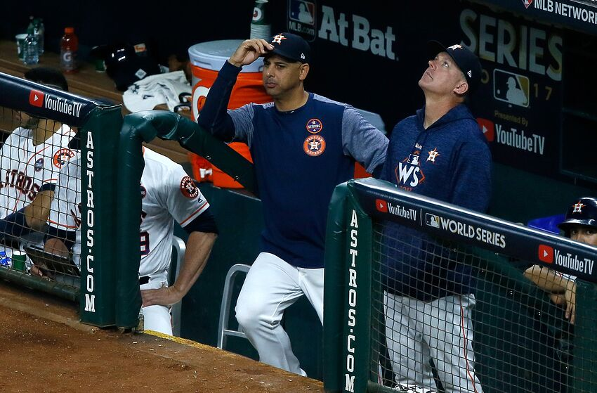 HOUSTON, TX - OCTOBER 29: Bench coach Alex Cora #26 and manager A.J. Hinch #14 of the Houston Astros look on from the dugout during the fifth inning against the Los Angeles Dodgers in game five of the 2017 World Series at Minute Maid Park on October 29, 2017 in Houston, Texas. (Photo by Bob Levey/Getty Images)