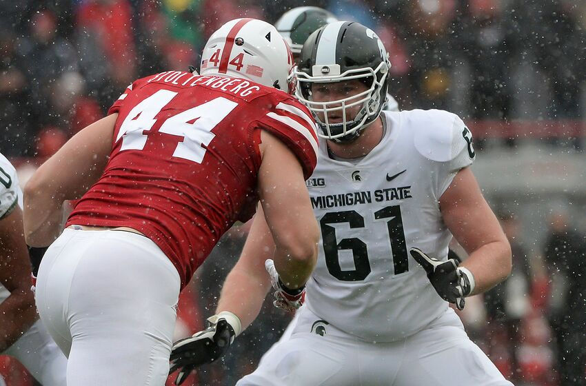 LINCOLN, NE - NOVEMBER 17: Offensive tackle Cole Chewins #61 of the Michigan State Spartans blocks defensive lineman Mick Stoltenberg #44 of the Nebraska Cornhuskers at Memorial Stadium on November 17, 2018 in Lincoln, Nebraska. (Photo by Steven Branscombe/Getty Images)