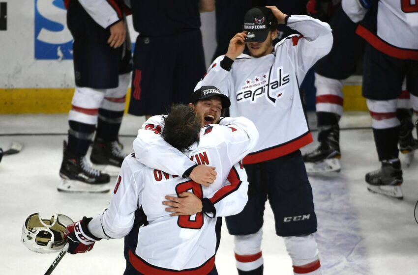 TAMPA BAY, FL - MAY 23: Washington Capitals defenseman John Carlson (74) hugs left wing Alex Ovechkin (8) at the end of Game 7 of the Eastern Conference Finals between the Washington Capitals and the Tampa Bay Lightning on Wednesday, May 23, 2018. (Photo by Jonathan Newton/The Washington Post via Getty Images)