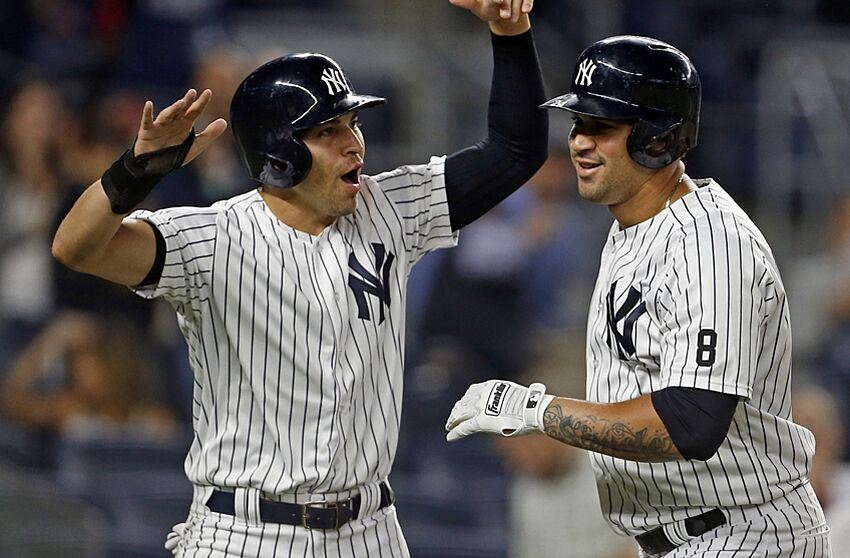 Sep 27, 2016; Bronx, NY, USA; New York Yankees catcher Gary Sanchez (24) celebrates hitting a two-run home run with New York Yankees center fielder Jacoby Ellsbury (22) during the first inning against the Boston Red Sox at Yankee Stadium. Mandatory Credit: Adam Hunger-USA TODAY Sports