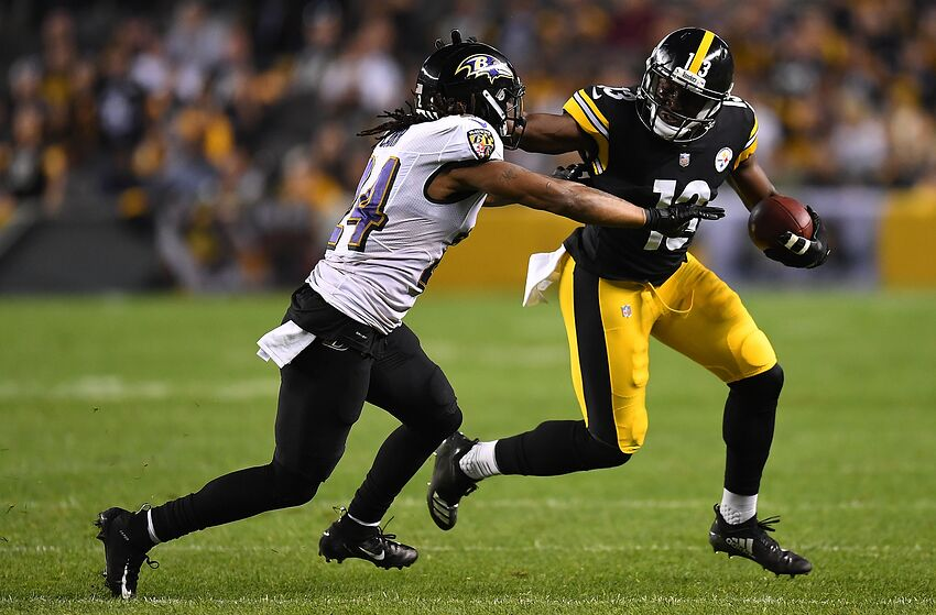 PITTSBURGH, PA - SEPTEMBER 30: James Washington #13 of the Pittsburgh Steelers runs upfield after a catch as Brandon Carr #24 of the Baltimore Ravens defends during the game at Heinz Field on September 30, 2018 in Pittsburgh, Pennsylvania. (Photo by Joe Sargent/Getty Images)
