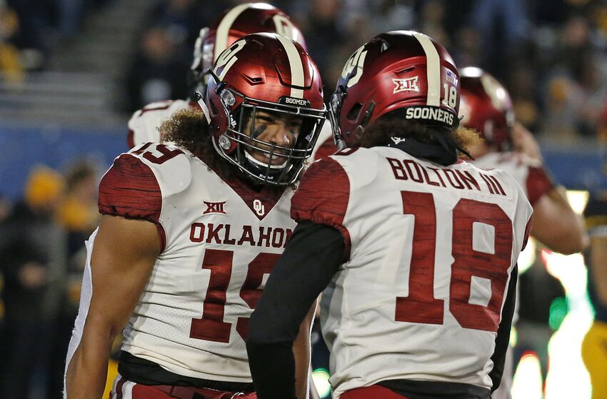 MORGANTOWN, WV - NOVEMBER 23: Caleb Kelly #19 of the Oklahoma Sooners celebrates after forcing and recovering a fumble for a 10 yard touchdown against the West Virginia Mountaineers on November 23, 2018 at Mountaineer Field in Morgantown, West Virginia. (Photo by Justin K. Aller/Getty Images)