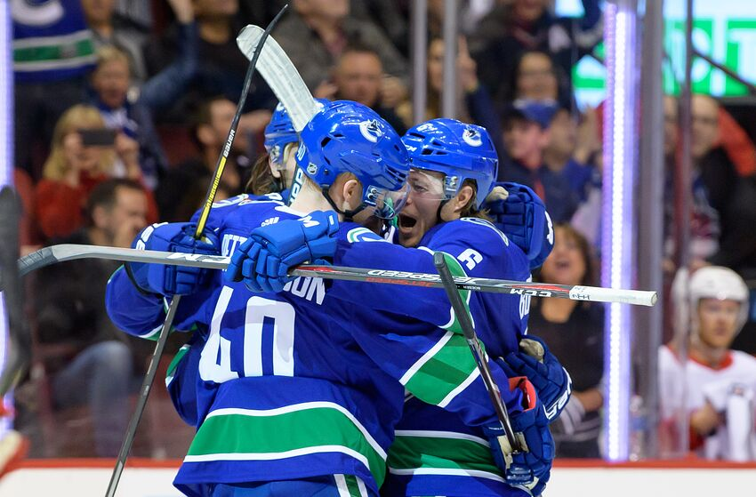 VANCOUVER, BC - JANUARY 20: Vancouver Canucks Center Bo Horvat (53) is congratulated by Center Elias Pettersson (40) and Right wing Brock Boeser (6) after scoring a goal against the Detroit Red Wings during their NHL game at Rogers Arena on January 20, 2019 in Vancouver, British Columbia, Canada. Vancouver won 3-2. (Photo by Derek Cain/Icon Sportswire via Getty Images)