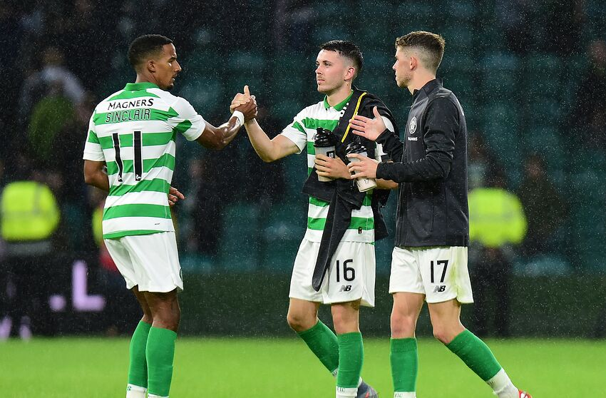 GLASGOW, SCOTLAND - JULY 17: Scott Sinclair and Lewis Morgan of Celtic at the final whistle during the UEFA Champions League First Qualifying Round 2nd Leg match between Celtic and FC Sarajevo at Celtic Park Stadium on July 17, 2019 in Glasgow, Scotland. (Photo by Mark Runnacles/Getty Images)