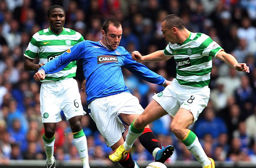 GLASGOW, SCOTLAND - OCTOBER 4: Landy N'Guemo of Celtic, Kris Boyd of Rangers and Scott Brown of Celtic in action during the Clydesdale Bank Scottish Premier League match between Rangers and Celtic at Ibrox on October 4, 2009 in Glasgow, Scotland. (Photo by Ian MacNicol/Getty Images)
