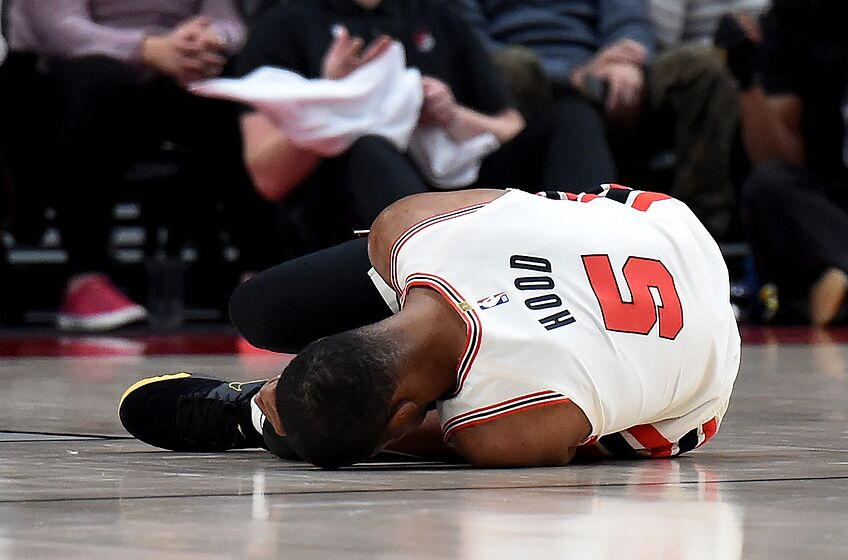 PORTLAND, OREGON - DECEMBER 06: Rodney Hood #5 of the Portland Trail Blazers lays on the court after being injured during the first half of the game against the Los Angeles Lakers at Moda Center on December 06, 2019 in Portland, Oregon. NOTE TO USER: User expressly acknowledges and agrees that, by downloading and or using this photograph, User is consenting to the terms and conditions of the Getty Images License Agreement. (Photo by Steve Dykes/Getty Images)