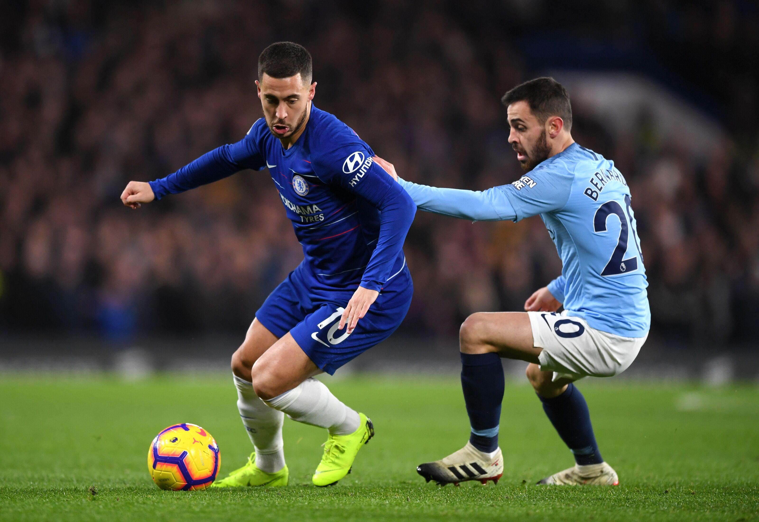 London England December  Eden Hazard Of Chelsea Is Challenged By Bernardo Silva