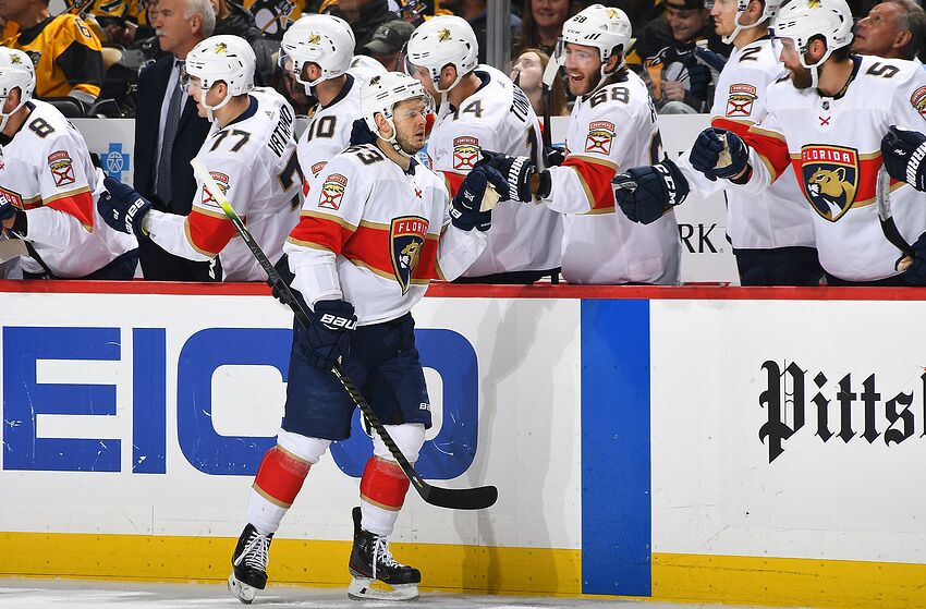 PITTSBURGH, PA - JANUARY 05: Evgenii Dadonov #63 of the Florida Panthers celebrates his goal with the bench during the third period against the Pittsburgh Penguins at PPG PAINTS Arena on January 5, 2020 in Pittsburgh, Pennsylvania. (Photo by Joe Sargent/NHLI via Getty Images)