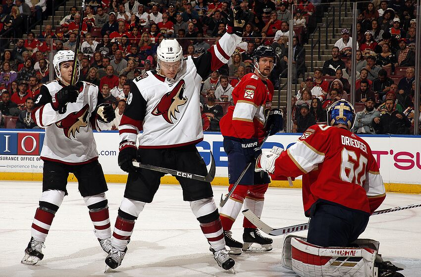 SUNRISE, FL - JANUARY 07: Christian Dvorak #18 of the Arizona Coyotes celebrates his goal with teammate Clayton Keller #9 during the second period against Goaltender Chris Driedger #60 of the Florida Panthers at the BB&T Center on January 7, 2020 in Sunrise, Florida. (Photo by Eliot J. Schechter/NHLI via Getty Images)