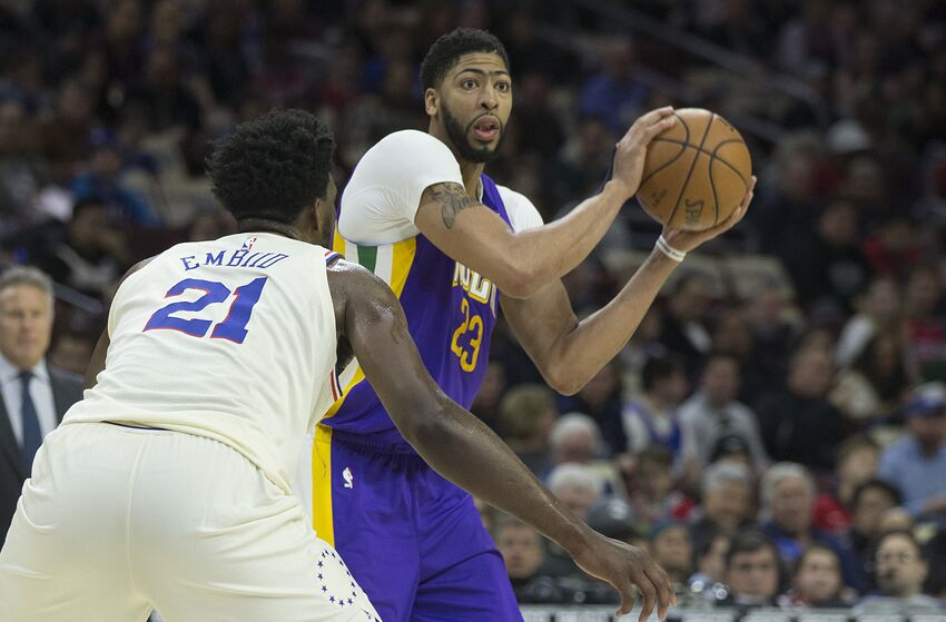 PHILADELPHIA, PA - FEBRUARY 9: Anthony Davis #23 of the New Orleans Pelicans looks to pass the ball against Joel Embiid #21 of the Philadelphia 76ers in the third quarter at the Wells Fargo Center on February 9, 2018 in Philadelphia, Pennsylvania. The 76ers defeated the Pelicans 100-82. NOTE TO USER: User expressly acknowledges and agrees that, by downloading and or using this photograph, User is consenting to the terms and conditions of the Getty Images License Agreement. (Photo by Mitchell Leff/Getty Images)