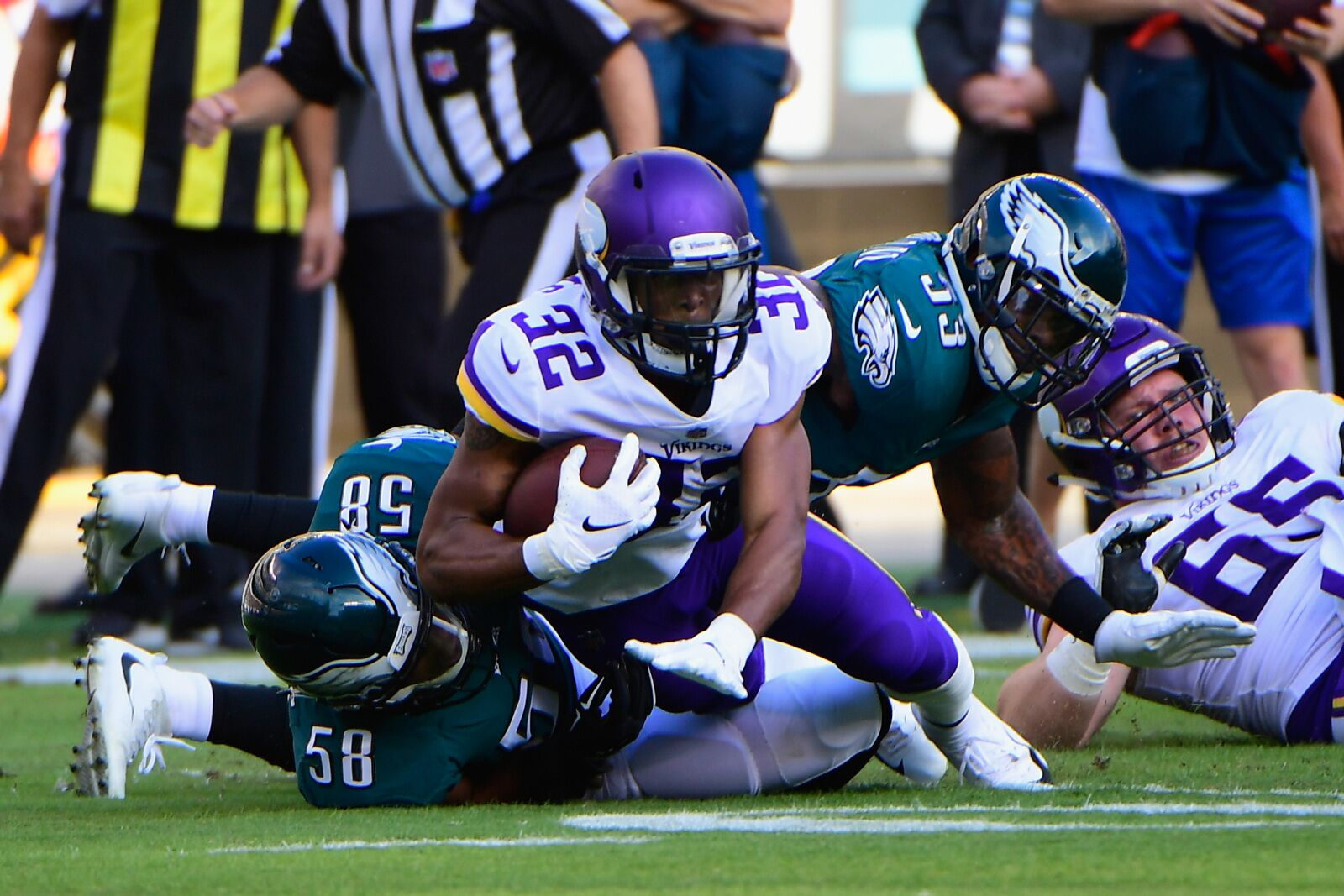 PHILADELPHIA, PA - OCTOBER 07: Running back Roc Thomas #32 of the Minnesota Vikings is tackled by linebacker Jordan Hicks #58 and linebacker Nigel Bradham #53 of the Philadelphia Eagles during the first quarter at Lincoln Financial Field on October 7, 2018 in Philadelphia, Pennsylvania. (Photo by Corey Perrine/Getty Images)
