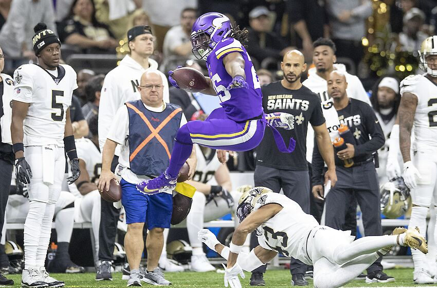 New Orleans, LA January 5: New Orleans Saints quarterback Teddy Bridgewater, left, watched as Minnesota Vikings running back Alexander Mattison hurdled over New Orleans Saints free safety Marcus Williams in the first quarter. (Photo by Elizabeth Flores /Star Tribune via Getty Images)