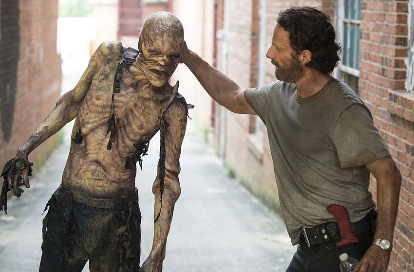 Andrew Lincoln as Rick Grimes and walker Stephen Vining. The Walking Dead. AMC