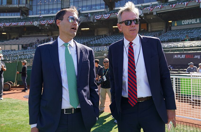 OAKLAND, CA - OCTOBER 02: Oakland Athletics President Dave Kaval (L) and General Manager Billy Beane (R) talk during batting practice prior to the start of the American League WildCard Game against the Tampa Bay Rays RingCentral Coliseum on October 2, 2019 in Oakland, California. (Photo by Thearon W. Henderson/Getty Images)