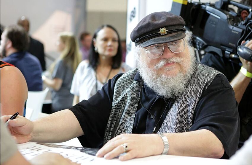 SAN DIEGO, CA - JULY 25: Writer George R.R. Martin of 'Game of Thrones' signs autographs during the 2014 Comic-Con International Convention-Day 3 at the San Diego Convention Center on July 25, 2014 in San Diego, California. (Photo by Tiffany Rose/Getty Images)
