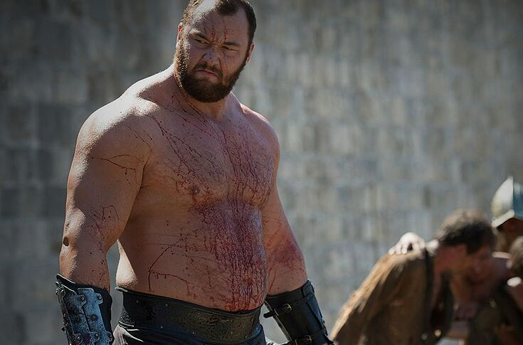 The Mountain reads love poems while lying shirtless on a couch