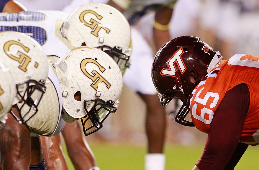 BLACKSBURG, VA - SEPTEMBER 03: Defensive players of the Georgia Tech Yellow Jackets line up against offensive players of the Virginia Tech Hokies at Lane Stadium on September 3, 2012 in Blacksburg, Virginia. (Photo by Geoff Burke/Getty Images)