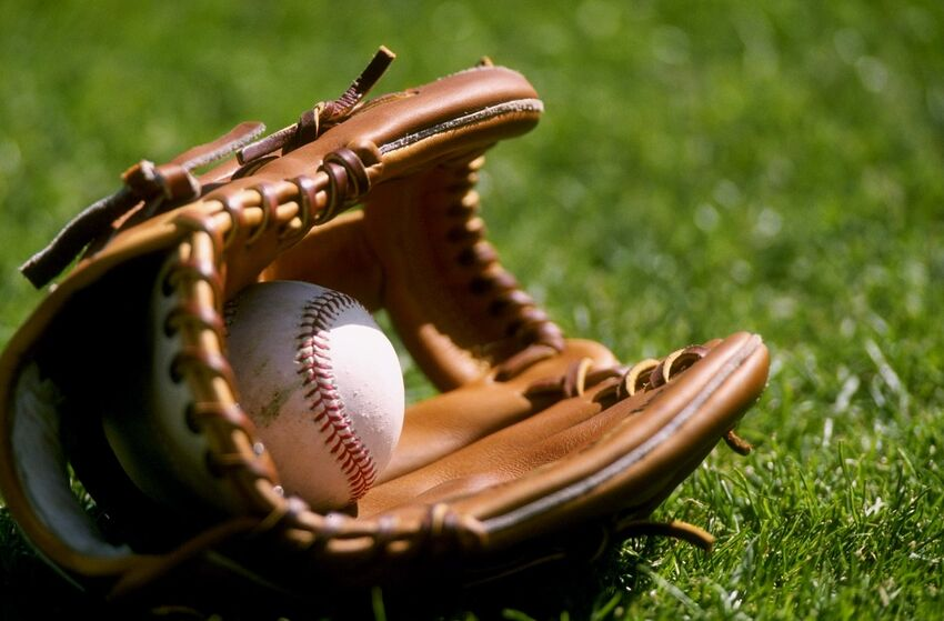 4 Mar 1998: A general view of a baseball laying in a glove on the grass during an Arizona Diamondbacks spring training game against the Chicago Cubs at Hohkam Stadium in Mesa, Arizona. The Diamondbacks defeated the Cubs 9-8.