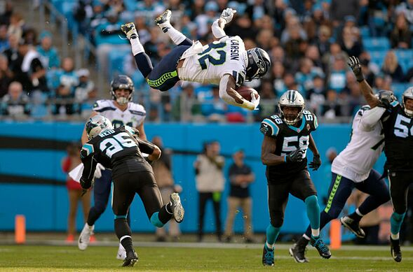 Chris Carson gets up for the Seahawks