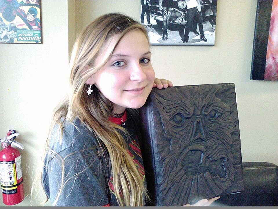 Harper Kurtz holding Necronomicon - Courtesy of Mercury Press