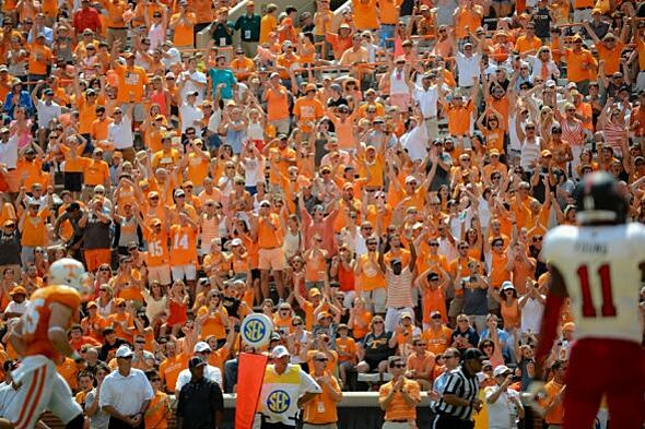 Sep 6, 2014; Knoxville, TN, USA; Tennessee Volunteers fans react after a touchdown against the Arkansas State Red Wolves during the second half at Neyland Stadium. Tennessee won 34 to 19. Mandatory Credit: Randy Sartin-USA TODAY Sports