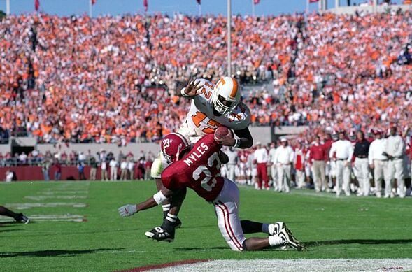 23 Oct 1999 Tee Martin 17 Of The Tennessee Volunteers Carries Ball As He Is Tackled By Reggie Myles Alabama Crimson Tide At Bryant