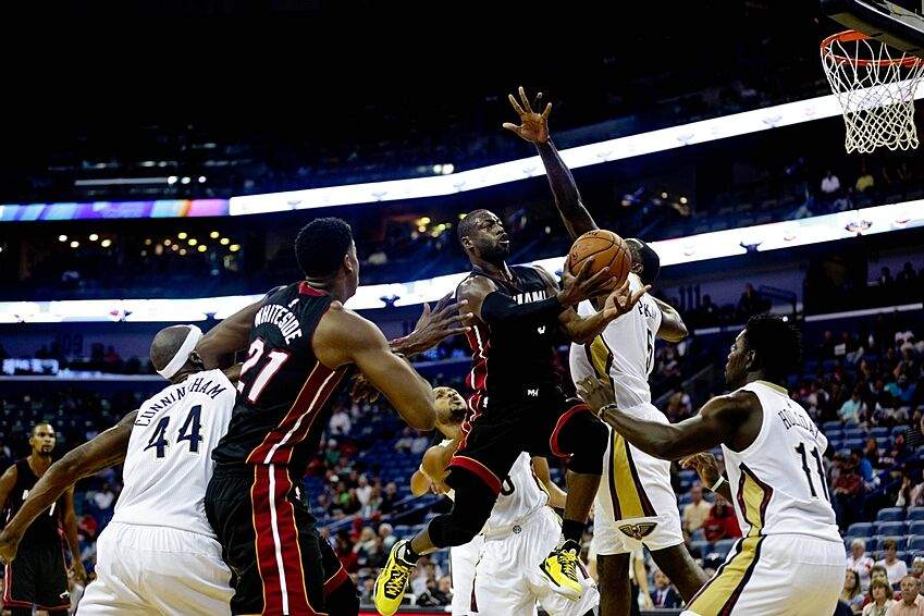 Oct 23 2017 New Orleans La Usa Miami Heat Guard Dwyane Wade 3 Is Defended By Pelicans Center Kendrick Perkins 5 And Eric Gordon