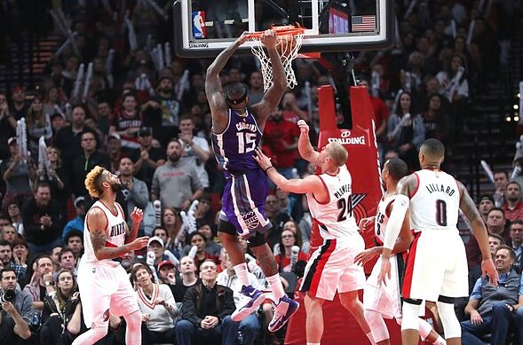 Nov 11, 2016; Portland, OR, USA; Sacramento Kings center DeMarcus Cousins (15) dunks over Portland Trail Blazers forward Mason Plumlee (24) in overtime at Moda Center at the Rose Quarter. Mandatory Credit: Jaime Valdez-USA TODAY Sports