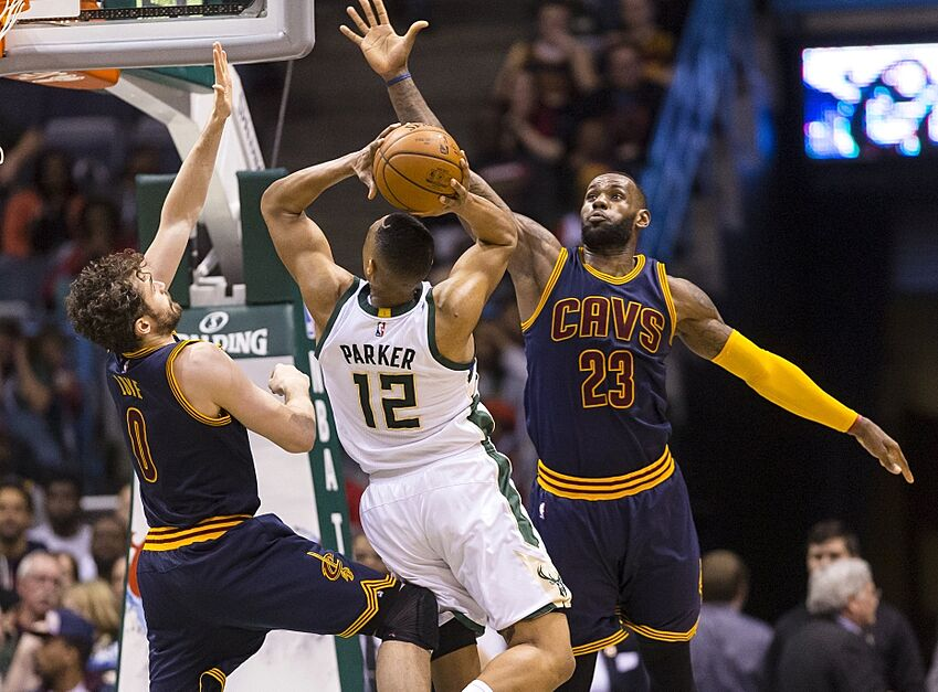 4c3c3c303666 ... Milwaukee Bucks forward Jabari Parker (12) shoots between Cleveland  Cavaliers forward Kevin Love (0) and forward LeBron James (23) during the  second ...
