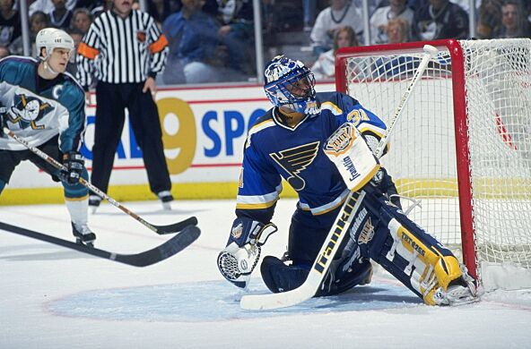 507888618bb 14 Apr 1999  Goalie Grant Fuhr  31 of the St. Louis Blues kneels as he  watches the puck during the game against the Anaheim Mighty Ducks at the  Arrowhead ...