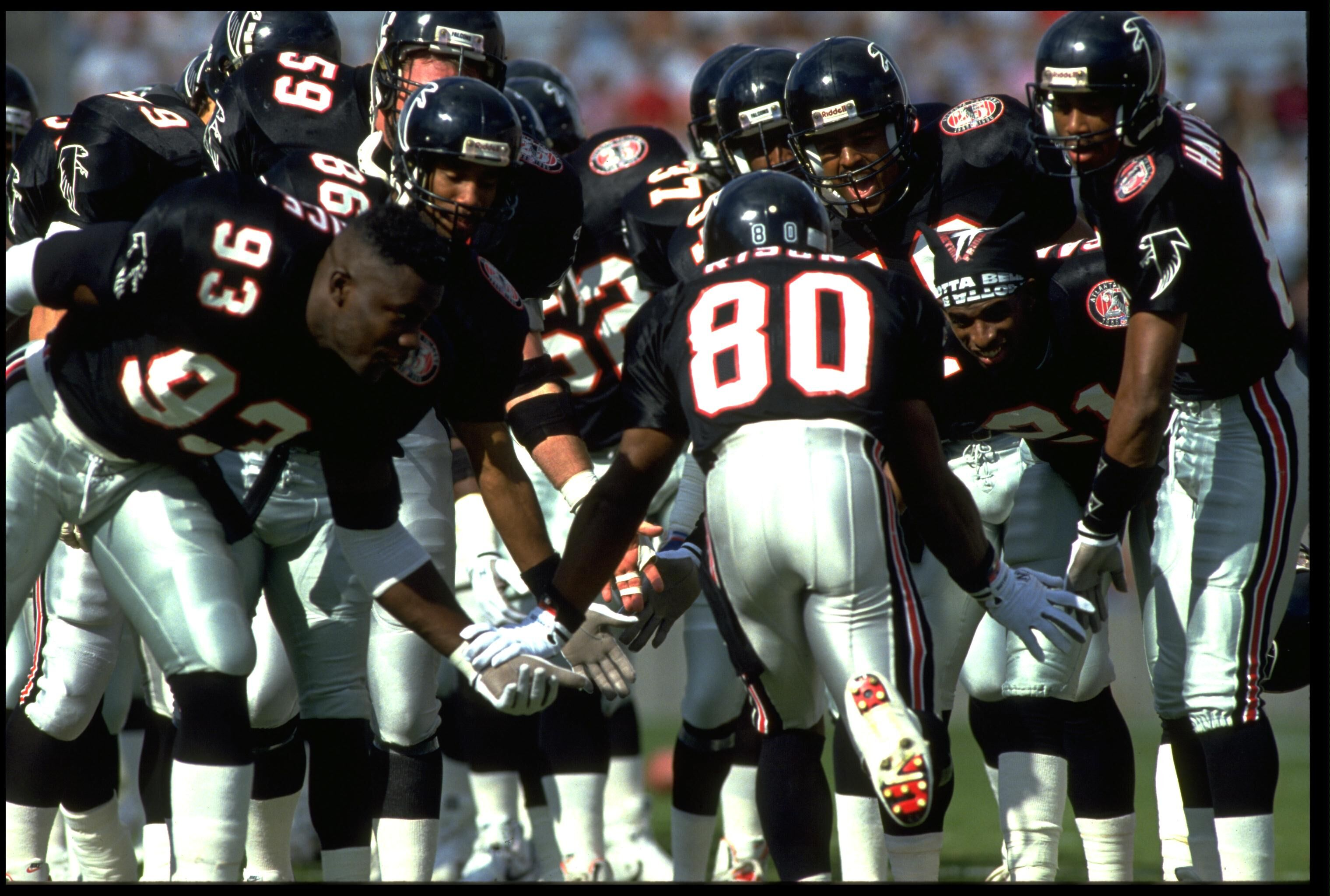 291023-andre-rison-and-falcons-team.jpg