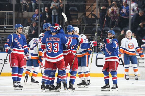 1648bc1ab05 NEW YORK, NY – JANUARY 10: Kevin Shattenkirk #22 of the New York Rangers  celebrates with teammates after scoring a goal min the second period  against the ...