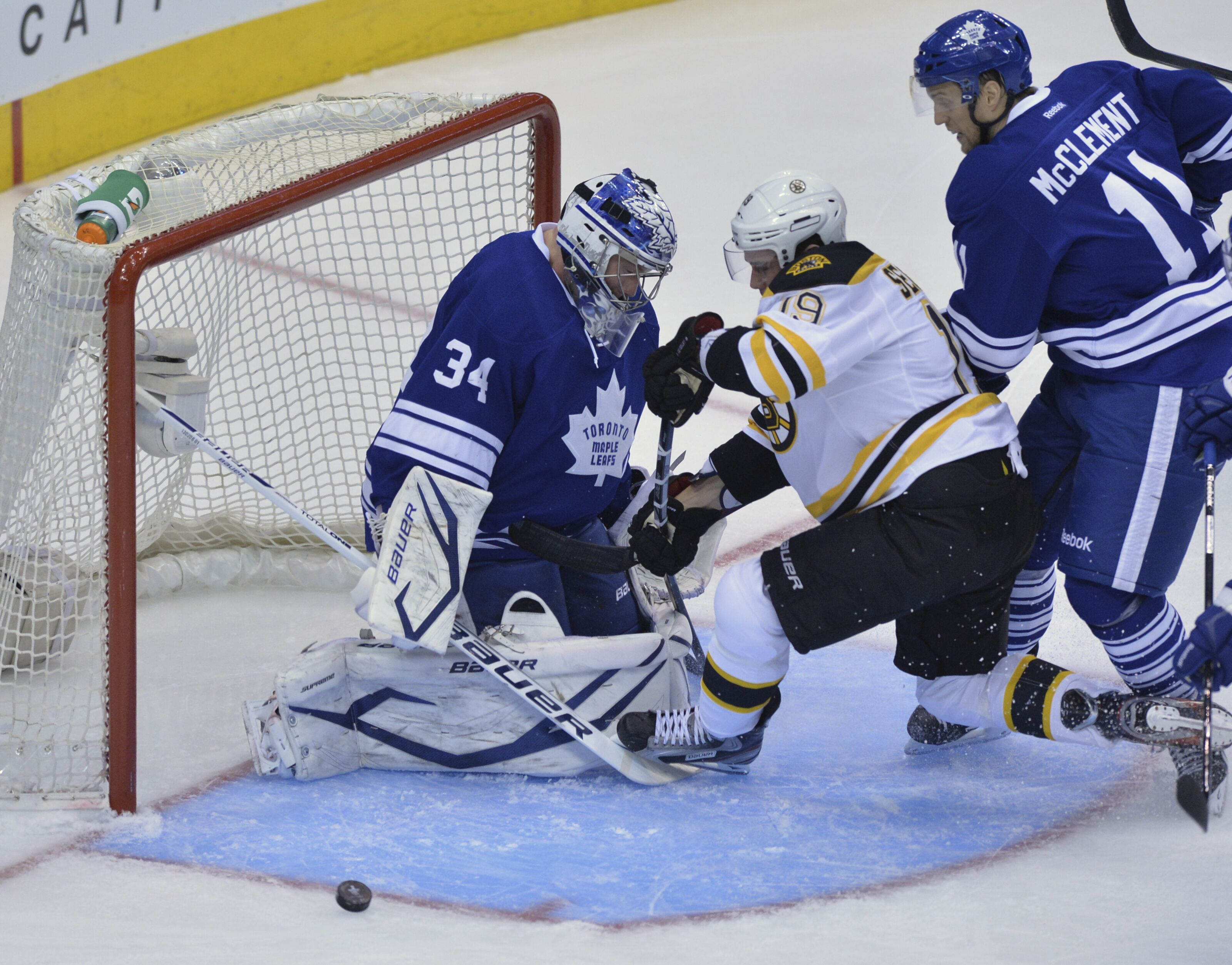 168323095-bostons-tyler-seguin-attempts-to-get-the-puck-past-leaf-netminder-james-reimer.jpg