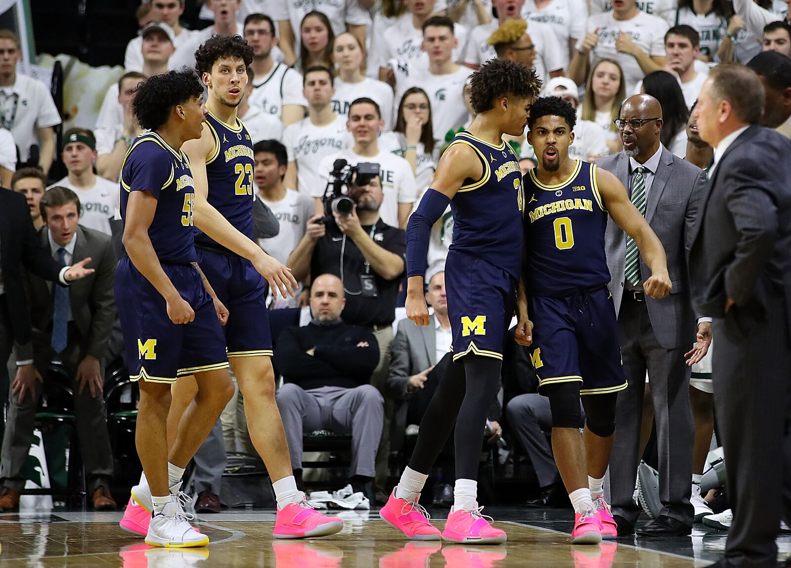 78d3982ccbe EAST LANSING, MI – MARCH 09: David DeJulius #0 of the Michigan Wolverines  celebrates with Jordan Poole #2 after making a layup during the first half  against ...