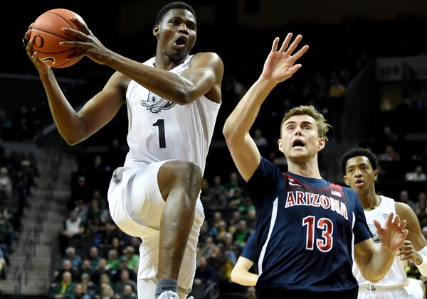 Oregon's freshman center, N'Faly Dante played very well in his team's overtime win over Arizona.  (Photo: Steve Dykes/Getty Images, via Busting Brackets.)