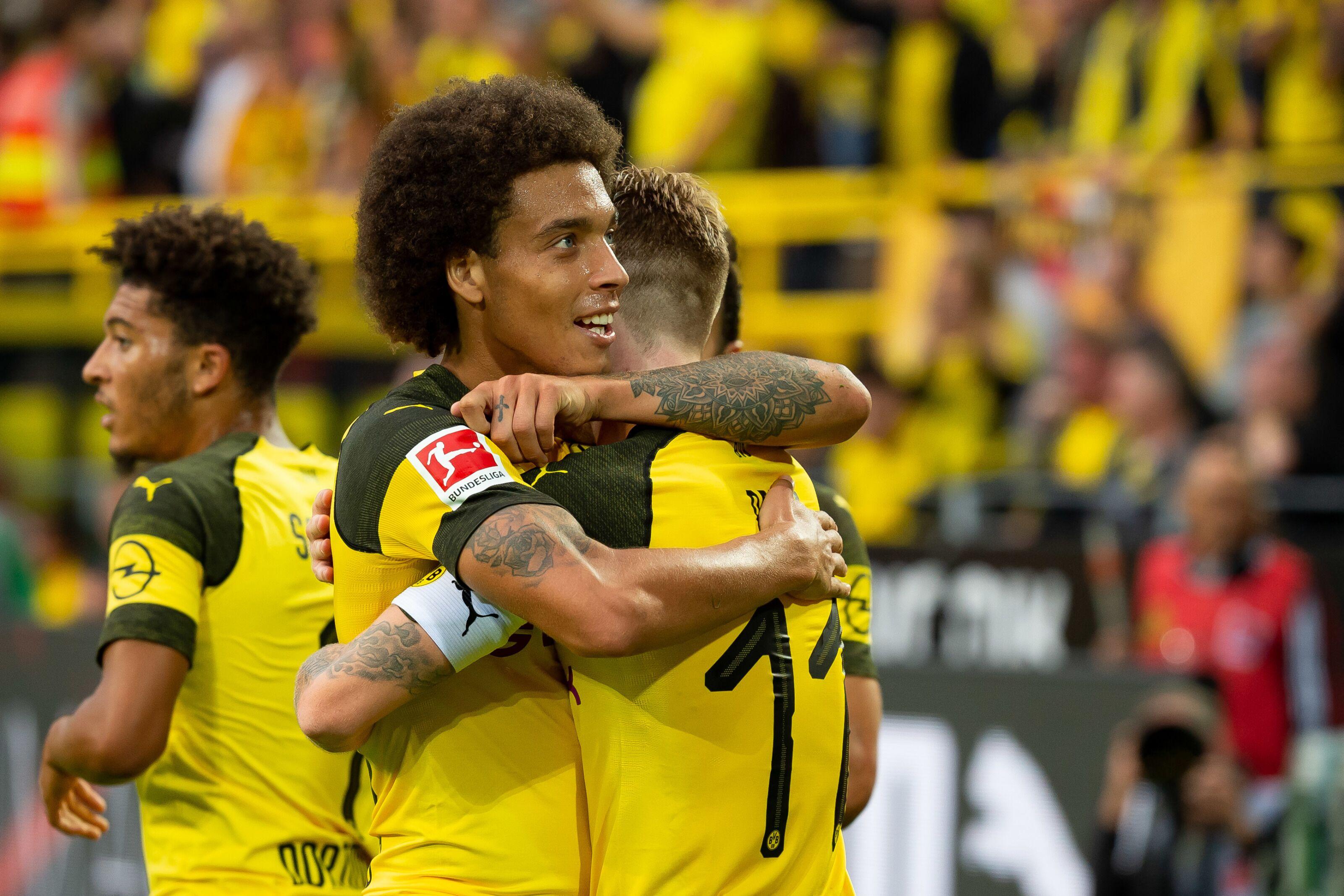 Dortmund Germany August 26 Marco Reus Of Borussia Dortmund Celebrates After Scoring His Teams Fourth Goal With Axel Witsel Of Borussia Dortmund During