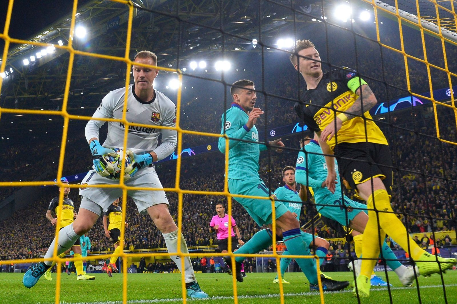 Barcelona survive Borussia Dortmund onslaught in Champions League opener