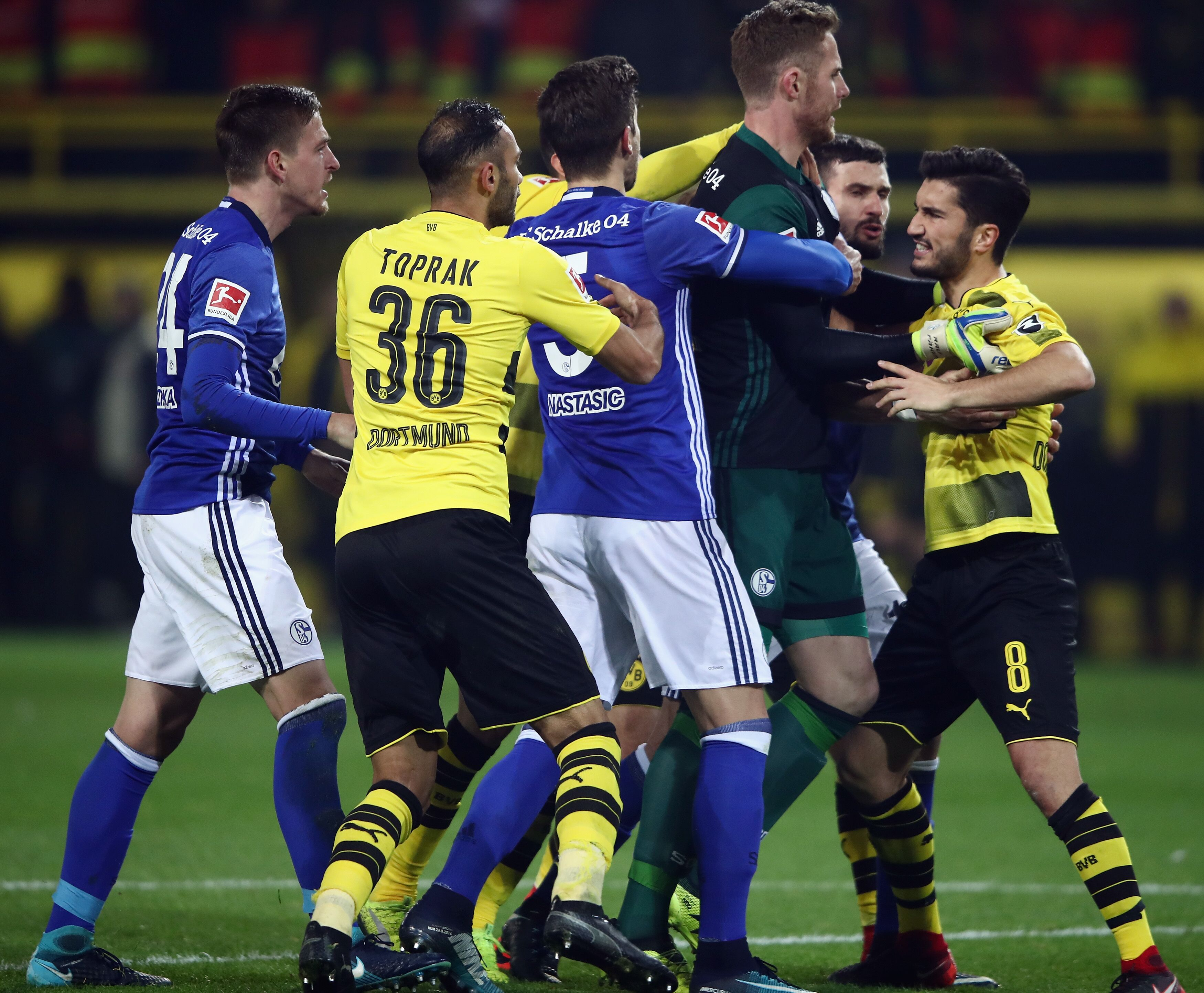 Dortmund Germany November 25 Goalkeeper Ralf Faehrmann Of Schalke And Nuri Sahin Of Dortmund Fight After The Bundesliga Match Between Borussia Dortmund