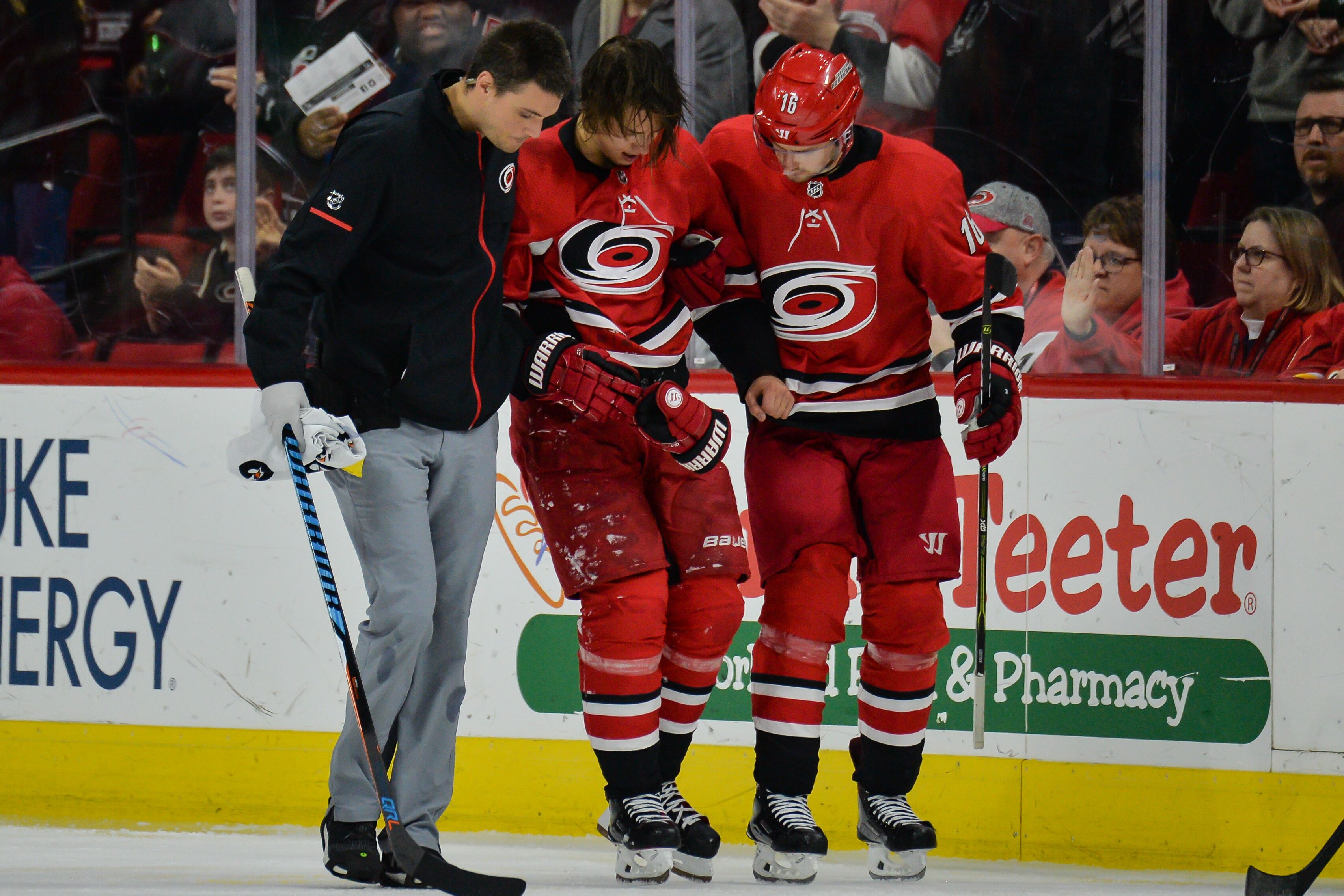 Raleigh Nc January  Carolina Hurricanes Center Marcus Kruger  Helps Carolina Hurricanes Left Wing Sebastian Aho  Off The Ice After Getting