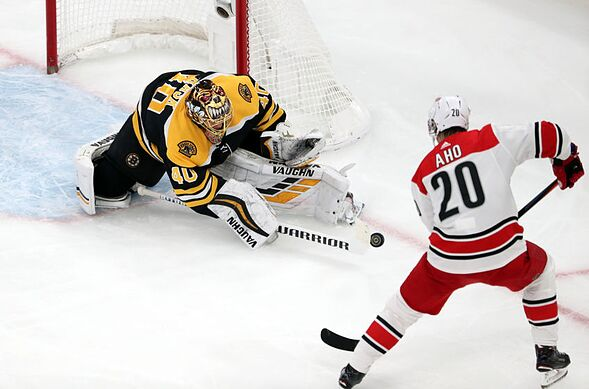big sale b584a eb1a1 BOSTON, MASSACHUSETTS – MAY 09  Tuukka Rask  40 of the Boston Bruins makes  a save against Sebastian Aho  20 of the Carolina Hurricanes during the  second ...
