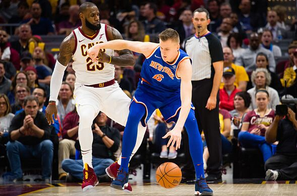 CLEVELAND, OH – OCTOBER 29 LeBron James 23 of the Cleveland Cavaliers  puts pressure on Kristaps Porzingis 6 of the New York Knicks during the  second half ...