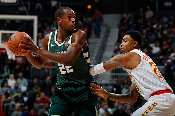 Atlanta Ga October 29 Khris Middleton 22 Of The Milwaukee Bucks Looks To P Against Kent Bazemore 24 Hawks At Philips Arena On
