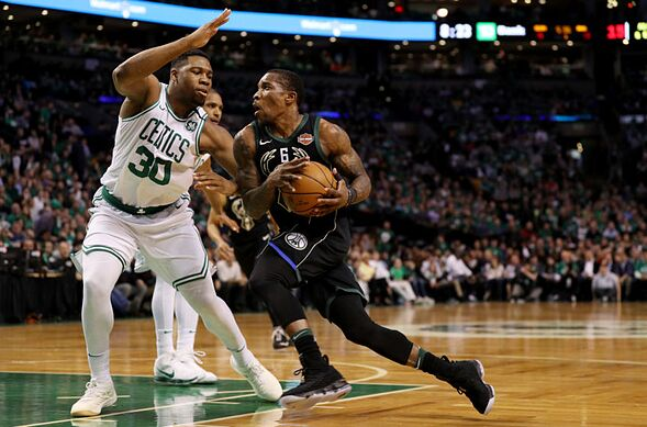 Boston Ma April 17 Eric Bledsoe 6 Of The Milwaukee Bucks Drives Against Guerschon Yabusele 30 Celtics In First Quarter Two