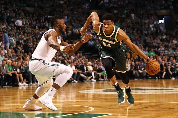 Boston Ma April 28 Giannis Antetokounmpo 34 Of The Milwaukee Bucks Drives Against Semi Ojeleye 37 Celtics During First Quarter