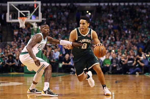 Boston Ma April 28 Malcolm Brogdon 13 Of The Milwaukee Bucks Drives Against Terry Rozier 12 Celtics During First Quarter