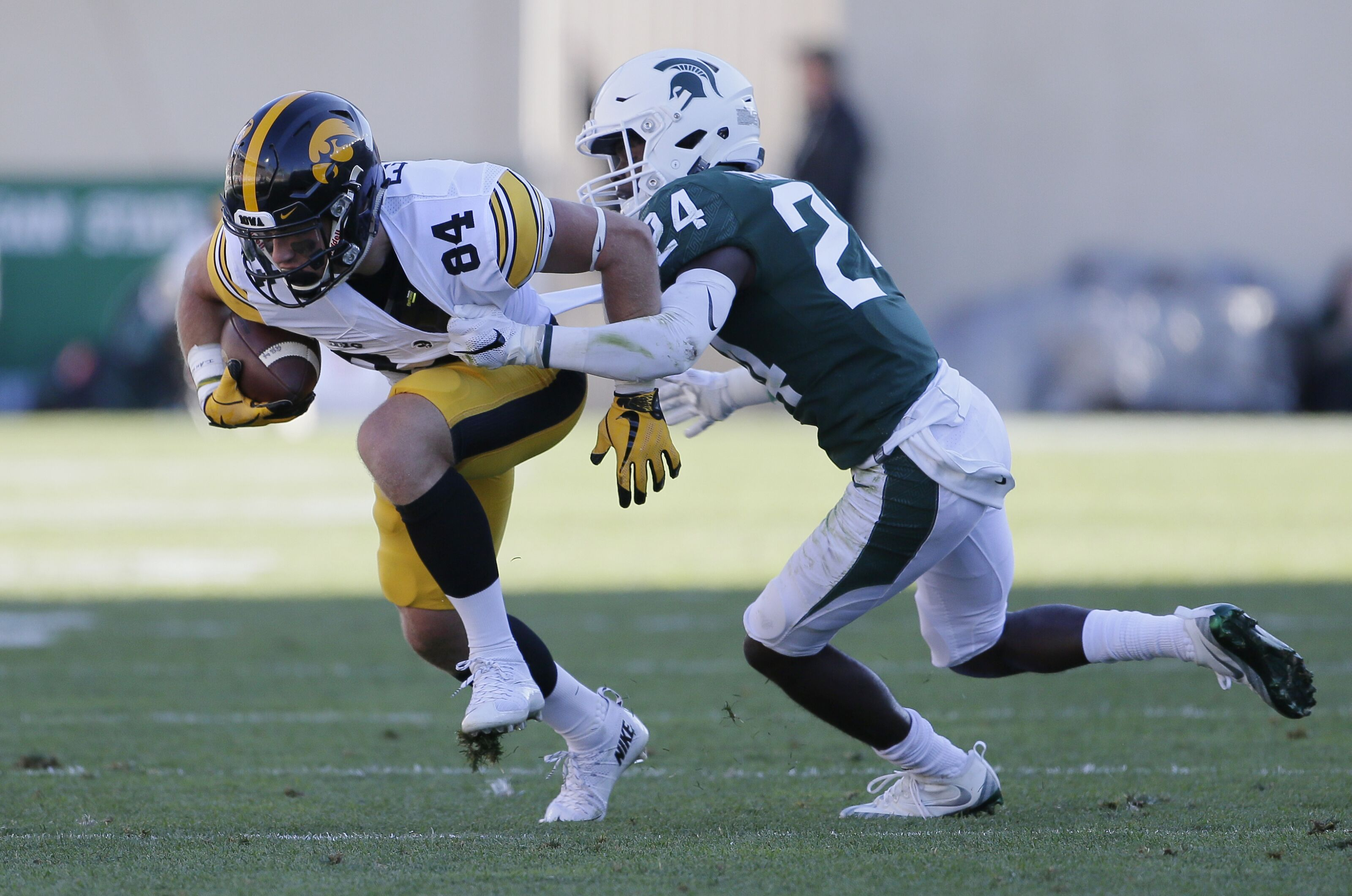 East Lansing Mi September 30 Wide Receiver Nick Easley 84 Of The Iowa Hawkeyes Is Tackled By Cornerback Tre Person 24 Of The Michigan State Spartans