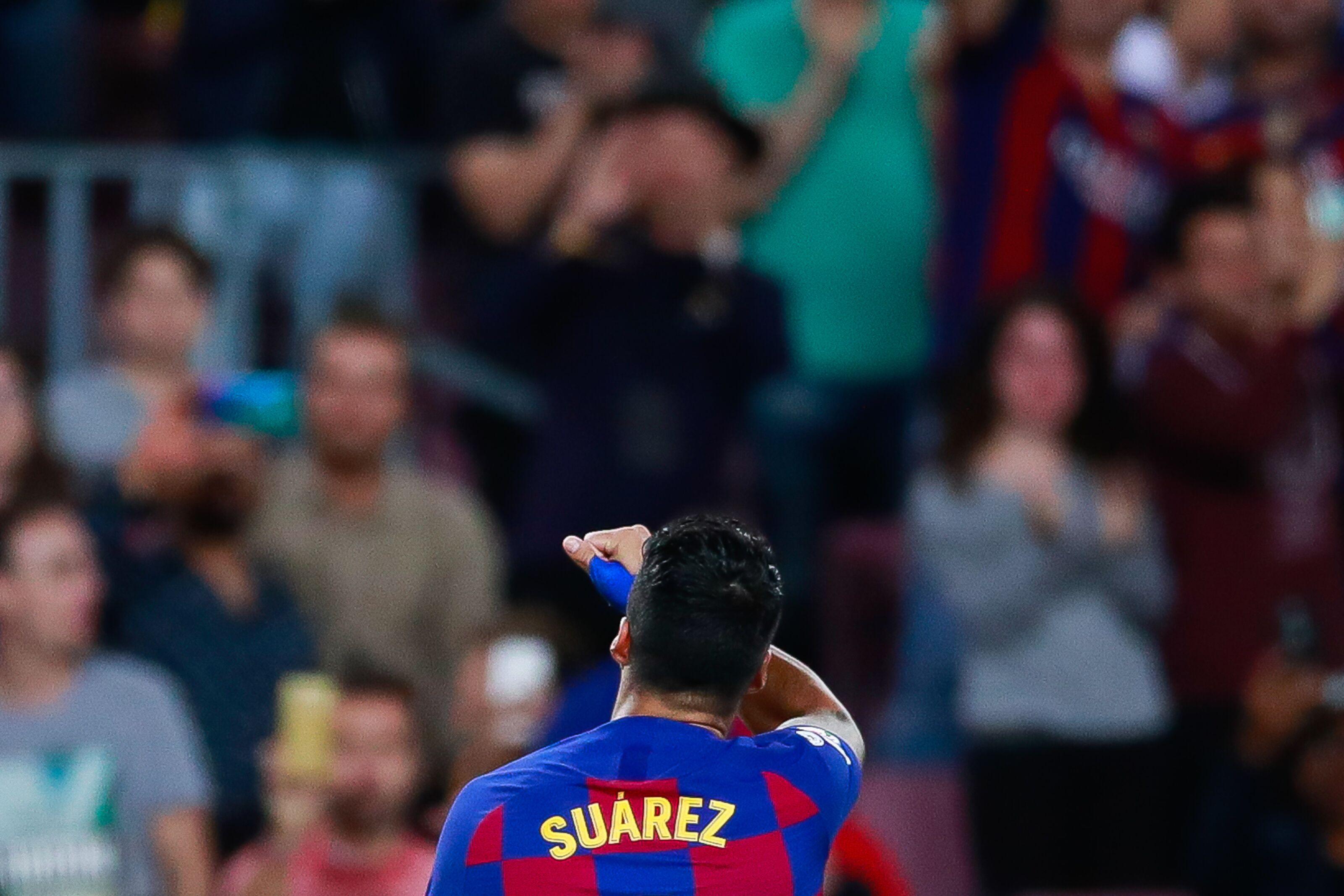 First-half blitzkrieg gets Barcelona 4-0 win over Sevilla