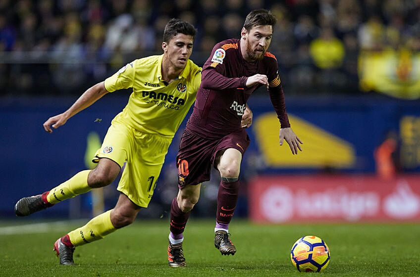 bc2ee42220b Leo Messi (R) of FC Barcelona competes for the ball with Rodrigo of  Villarreal CF during the La Liga game between Villarreal CF and FC  Barcelona at Estadio ...