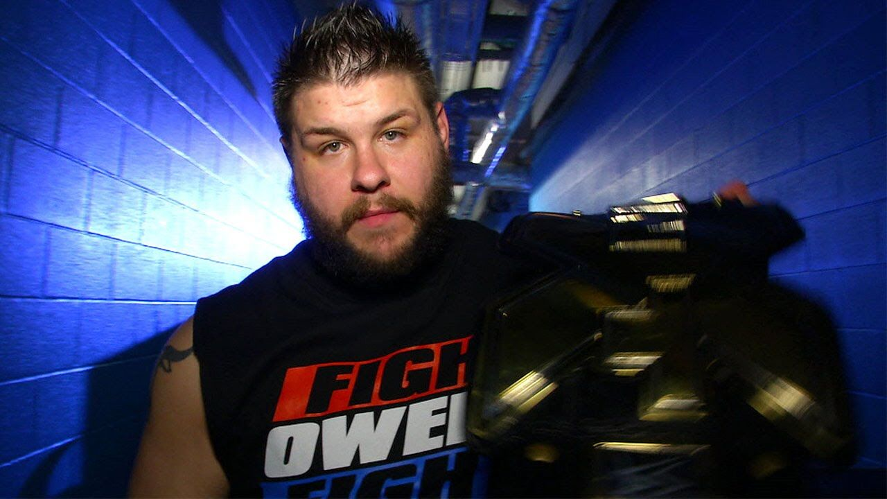 We go to the ring and out first comes Braun Strowman to the cage Kevin Owens is out next The bell rings and Braun immediately stops Owens from retreating